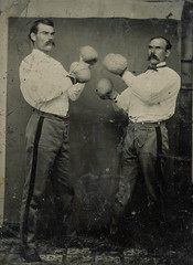Tin type of two men boxing in a studio
