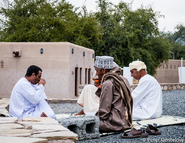 Tea drinkers outside Rustaq Fort