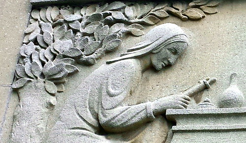 Woman Reading a Scroll
