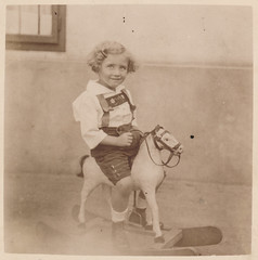 Little girl riding on a rocking horse