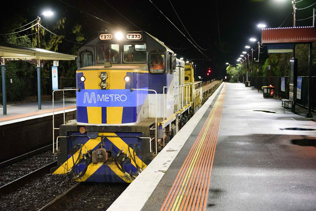 T373 with #7401 Metro rail train to Southland at Highett by Luke's Rail Gallery