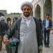 Mullah giving sweets to tourists visiting friday mosque for Public Relations operation filmed by iranian television, Isfahan Province, isfahan, Iran by Eric Lafforgue