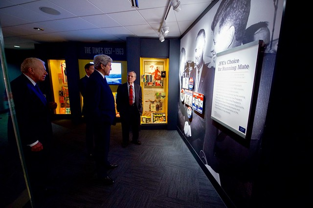 Secretary Kerry Looks at a Panel Describing John F. Kennedy's Choice of Lyndon Baines Johnson as His 1960 Running Mate While Touring the LBJ Presidential Library at the University of Texas at Austin