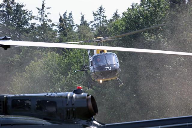 ZJ278 SQUIRREL LANDING BEHIND HUEY EAST FORTUNE 2014