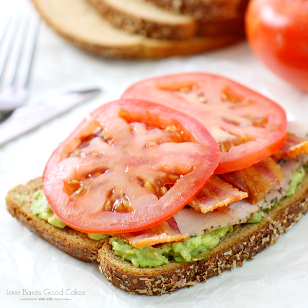 Shake up your lunch menu with this Turkey Avocado Bacon Tomato Sandwich! Makes an easy and light dinner idea too! AD