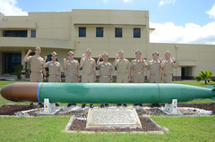 Members of the U.S. and Republic of Korea submarine forces pose outside Submarine Squadron 15 at Polaris Point, Naval Base Guam, to celebrate the conclusion of the 43rd Submarine Warfare Committee Meeting. (U.S. Navy/MC3 Allen McNair)