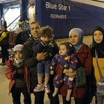 Ship carrying Syrian refugees from Greek islands arrives in Athens