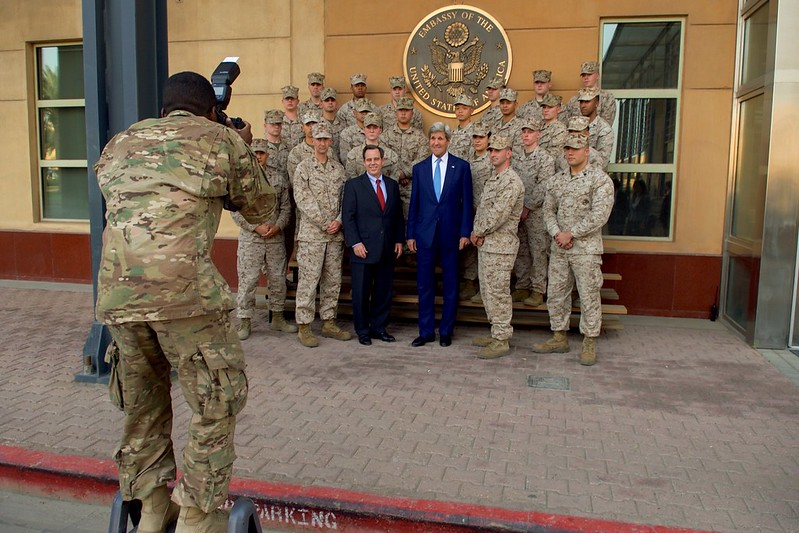 U.S. Army SPC Turnbow Takes a Photo of Secretary Kerry and U.S. Ambassador Jones With Members of the Marine Security Guard Detachment in Baghdad
