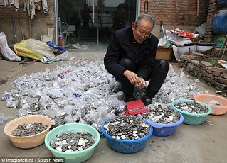 Chinese man with coin stash
