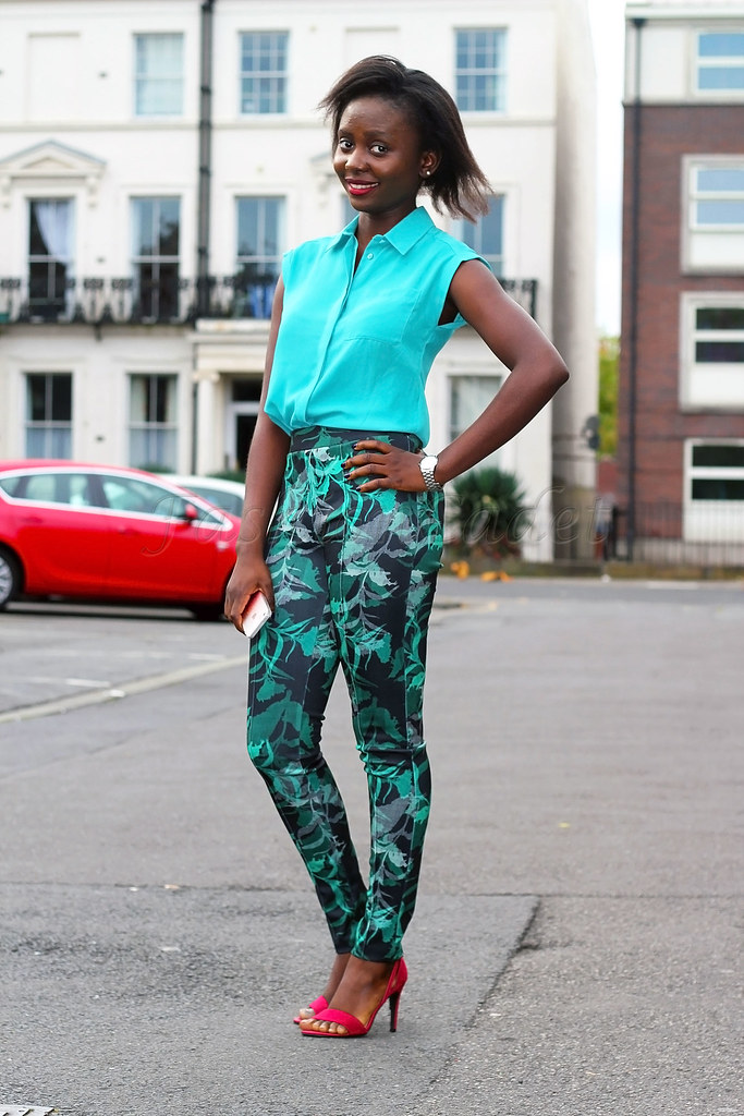 Tropical-print-slacks-with-sleeveless-turquoise-blouse,Green tropical print trousers, sleeveless turquoise blouse, red barely there strappy sandals, strappy heeled sandals
