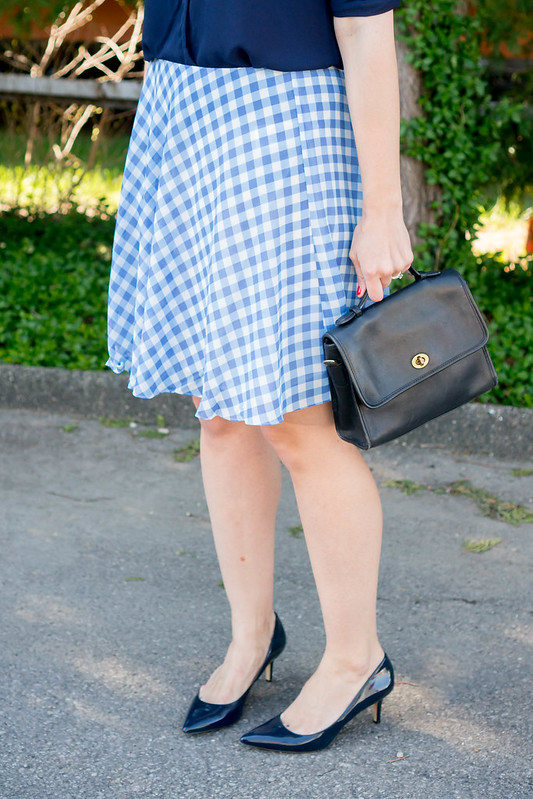 navy work blouse + blue gingham skirt + vintage brooch + loft sunglasses + spring summer work outfit