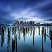 Lost Pier of Maverick Landing in East Boston with Decayed Pilings and Boston Skyline under Stormy Sky by Greg DuBois - Sponsored by LEE Filters