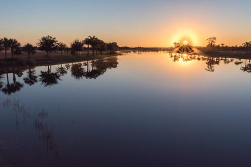 sky lake water sunrise florida swamp avemaria