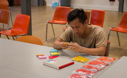 Sophomore transfer student and studio art major Julian Le works on a project for his Art and Design II class in the School of Visual Arts building. Le was working on a 1,000-piece art project made from folded paper cranes. At the time of the photo, he said he'd been working on the cranes for over 40 hours at least and had made about 300 out of 1,000. Photo by Scott Beaubien.