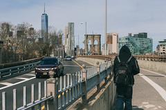 Man crossing the Brooklyn Bridge