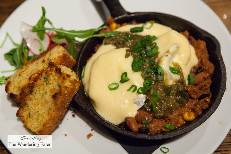 Chili braised pork shoulder, poached eggs, corn bread, hollandaise, salsa verde