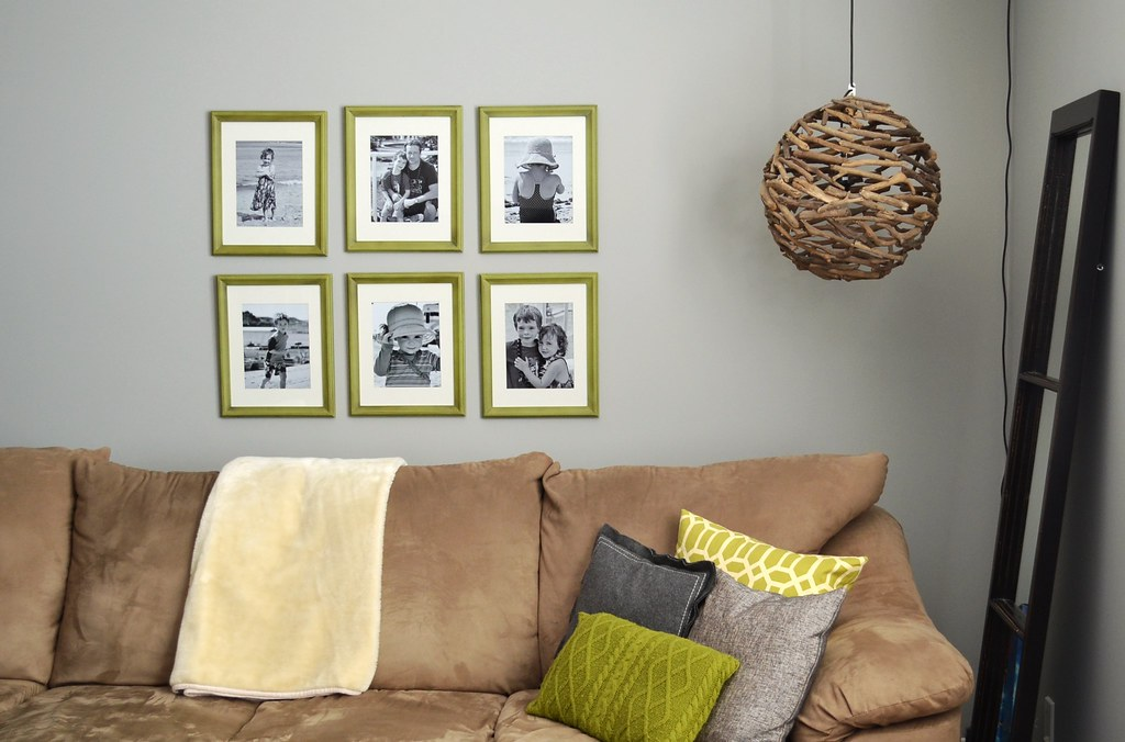 green frames in a grid pattern behind a sectional