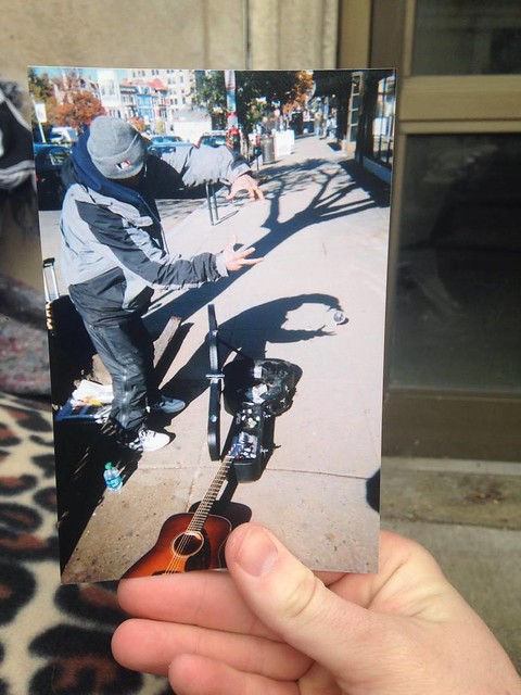 Photo of a photograph that Robin took of his guitar and another man | Photo by Colleen Cosgriff