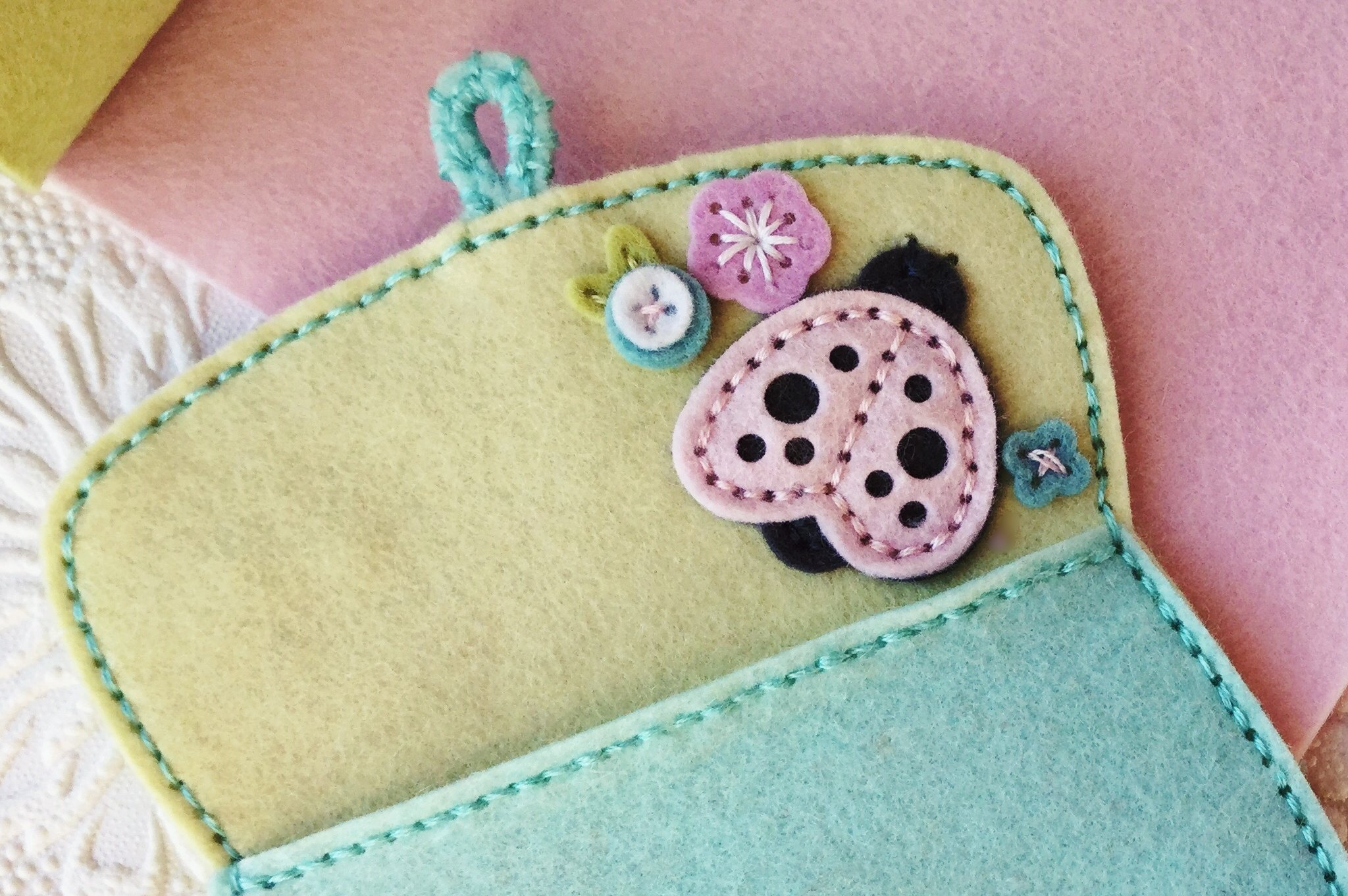 Sttiched Ladybug and Floral Cluster 1 on the inside of Copin Purse II Dies by Papertrey Ink