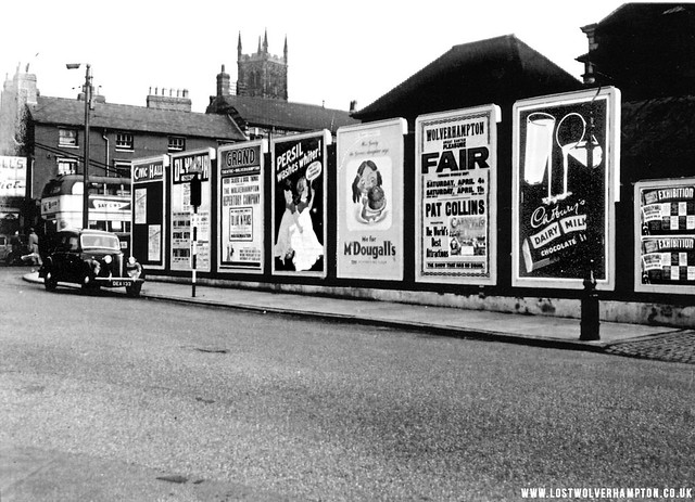 The row of billposters on the hoardings opposite the Molineux hotel.