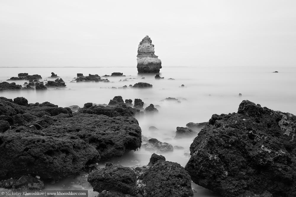 Black and white photo of rocky coastline of Atlantic ocean
