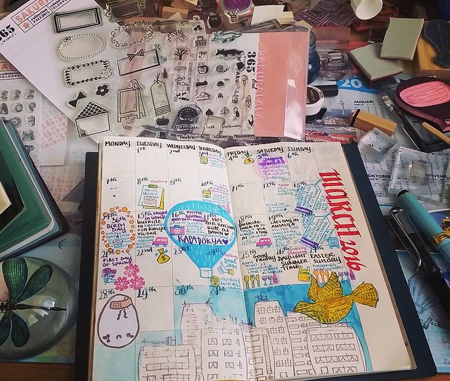 Updating my monthly midori planner for March #whatsonmydesk #midori #midoritravelersnotebook #plannerlife #planneraddict #monthlyplanning #sakuralala #rubberstamps #illustrated #journal #writing #stationeryaddict
