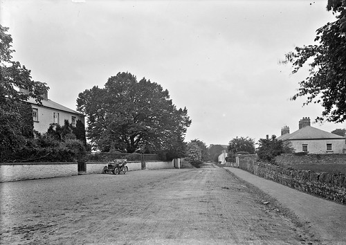 Roadway showing motor car parked outside house, Mountmellick, Co. Laois