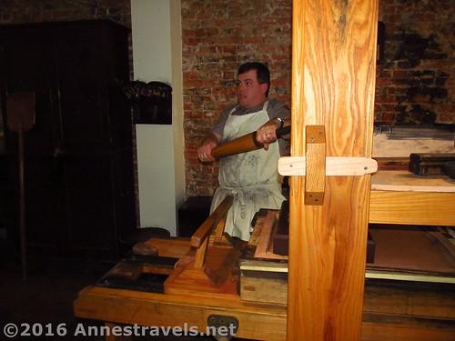 Demonstrating the printing press at Franklin Court, Independence National Historic Park, Philadelphia, Pennsylvania
