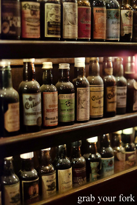 Vintage mini spirit bottles at Restaurant Hubert Sydney