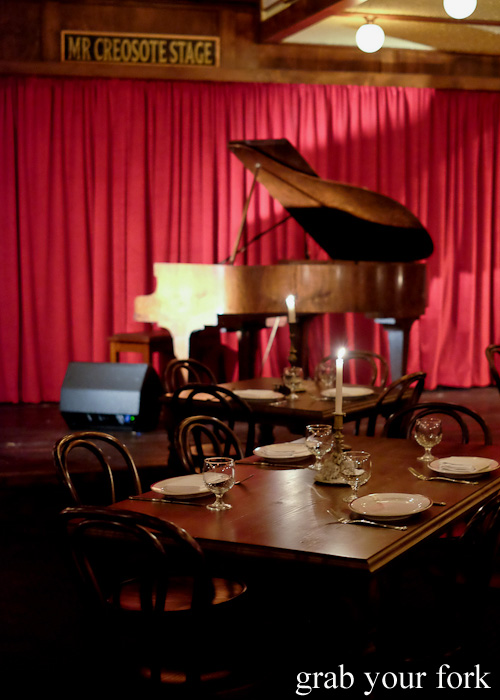 Mr Creosote Stage with the baby grand piano at Restaurant Hubert Sydney
