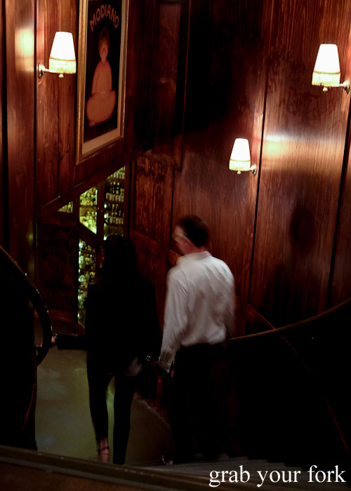 Descending the spiral staircase to Restaurant Hubert Sydney