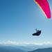 pink paraglider covering the sun