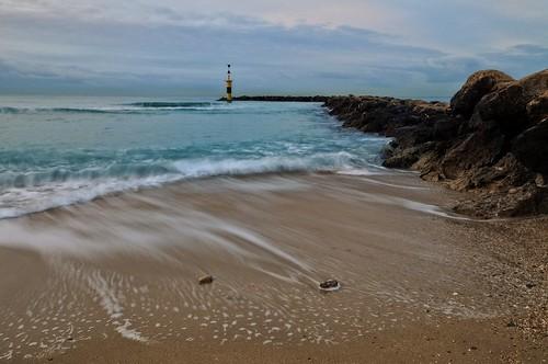 ocean longexposure blue sea sky lighthouse seascape beach water rock stone clouds port sunrise dawn pier seaside spain sand europe mediterranean waves jetty espana ibiza le mallorca palma hdr menorca arenal waterscape formentor balearic rabassa