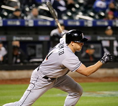 J.T. Realmuto swings at a pitch