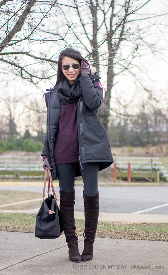 black parka, black infinity scarf, purple sweater tunic, burgundy gloves, brown suede over the knee boots
