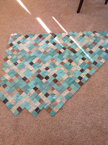 Nifty nines lattice with teal background, part of rows assembled.