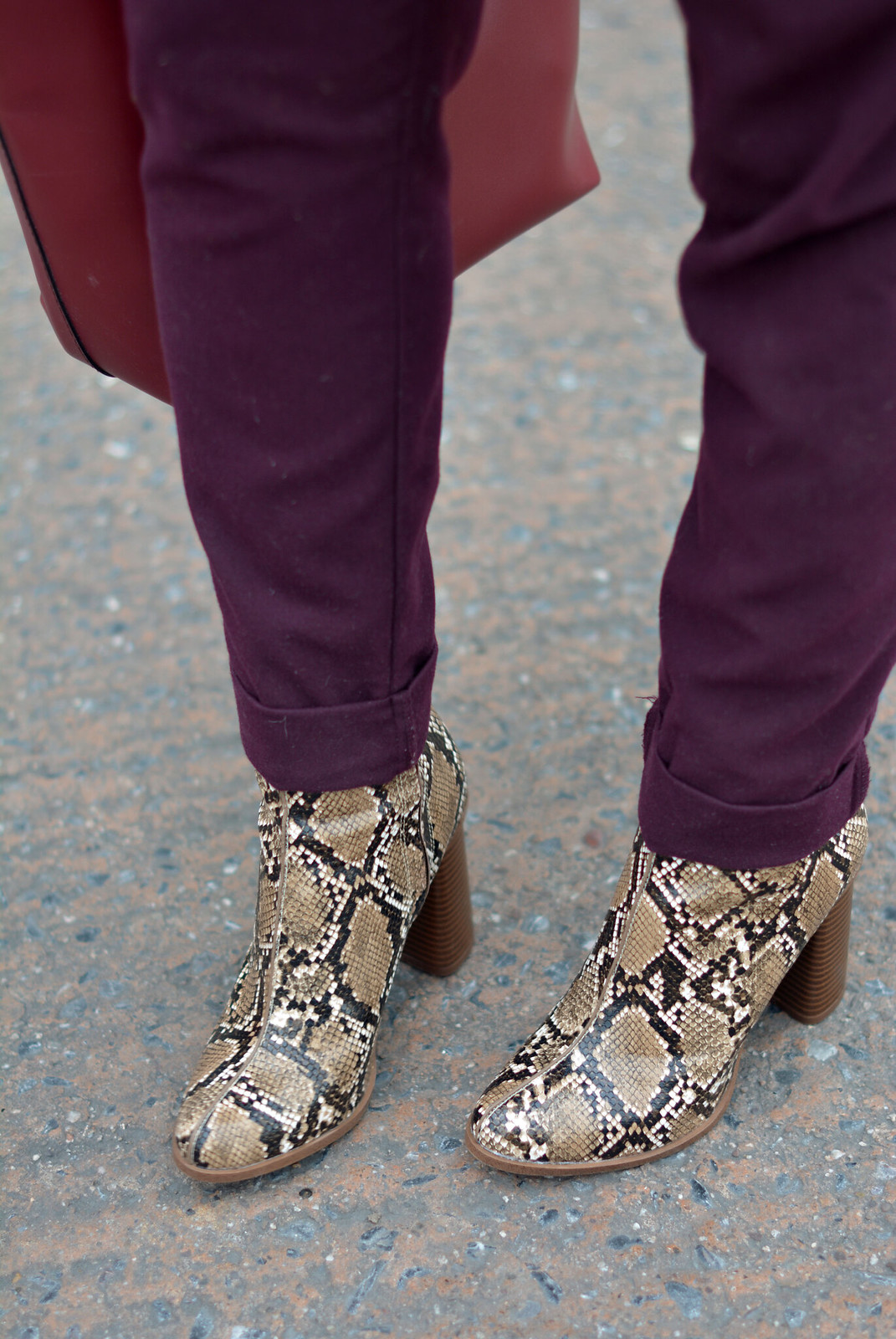 Purple trousers, red bucket bag, snakeskin boots