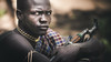 Marmol, a young armed Mursi man