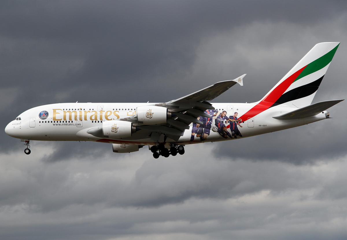 EK45 from Dubai DXB on short final for RWY25L under a dramatic sky. Paris St Germain Soccer livery. Delivered 12/2015.