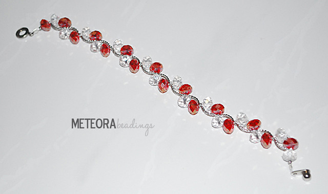 Bracelet - red and clear beads with silver spacers