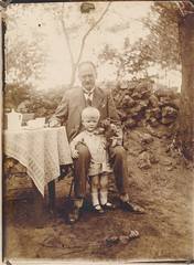 Father and child having tea outside