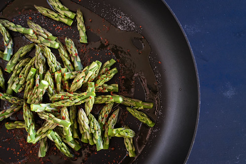 sautéing the asparagus tips with aleppo pepper