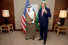 U.S. Secretary of State John Kerry, flanked by Saudi Foreign Minister Adel al-Jubeir, addresses reporters at the President Wilson Hotel in Geneva, Switzerland, on May 2, 2016, amid a series of meetings focused on the cessation of hostilities in Syria.  [State Department photo/ Public Domain]