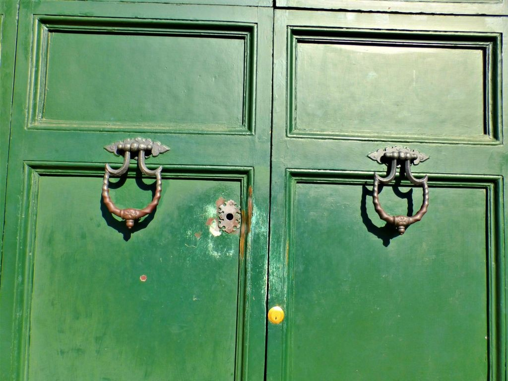 Green door with large keyhole