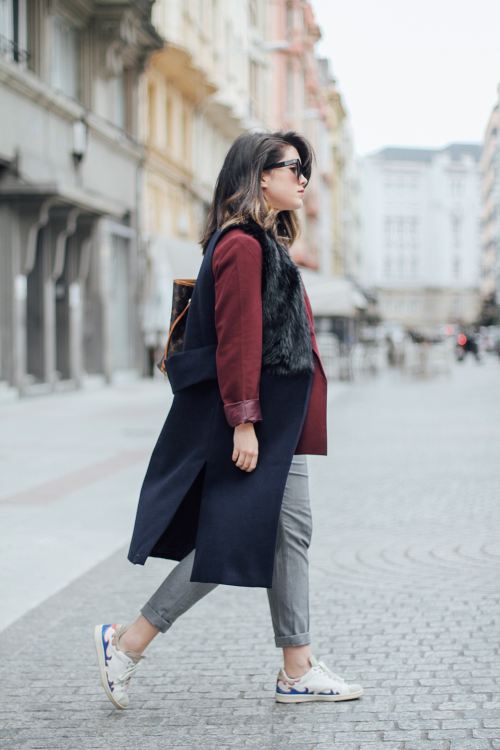 isabel marant sneakers with faux fur vest and red blazer streetstyle louis vuitton neverful