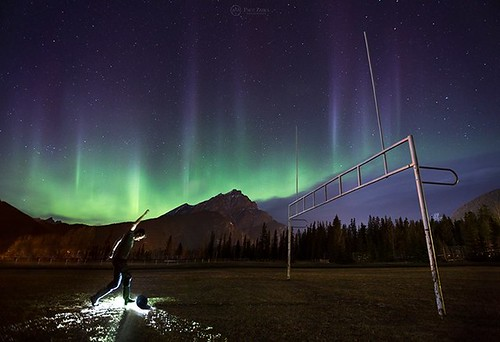 Playing Overtime... Self-portrait taken during the most spectacular part of our latest northern lights display here in Banff National Park. I was caught off guard so I only had a rolled up jacket for a ball, and a headlamp for lighting, but when the auror