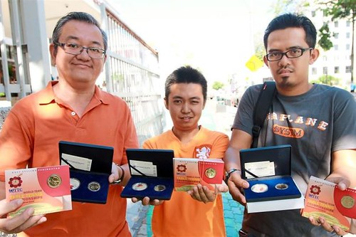 collectors with Malaysian coin sets