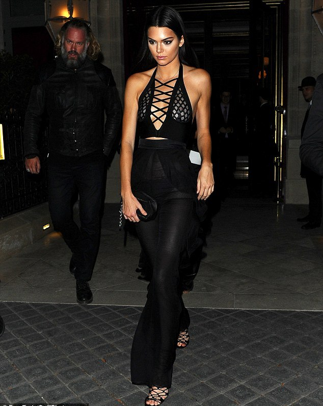 lace up haltered neck top with a pair of black high waisted trousers lace up shoes