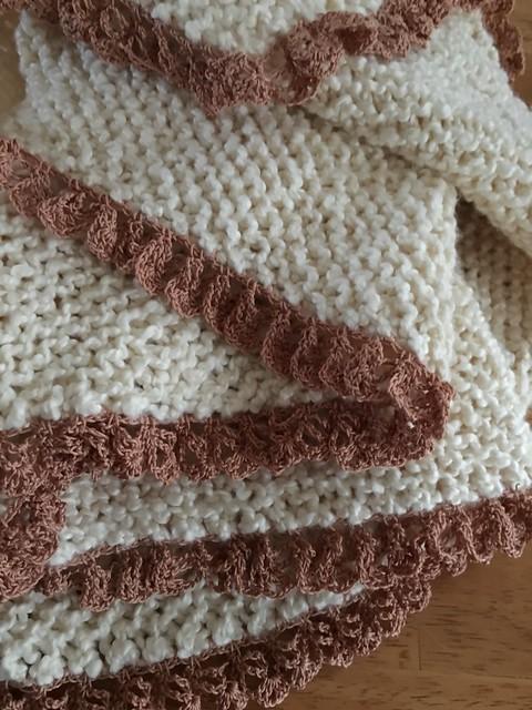 Cotton boucle blanket with crochet trim