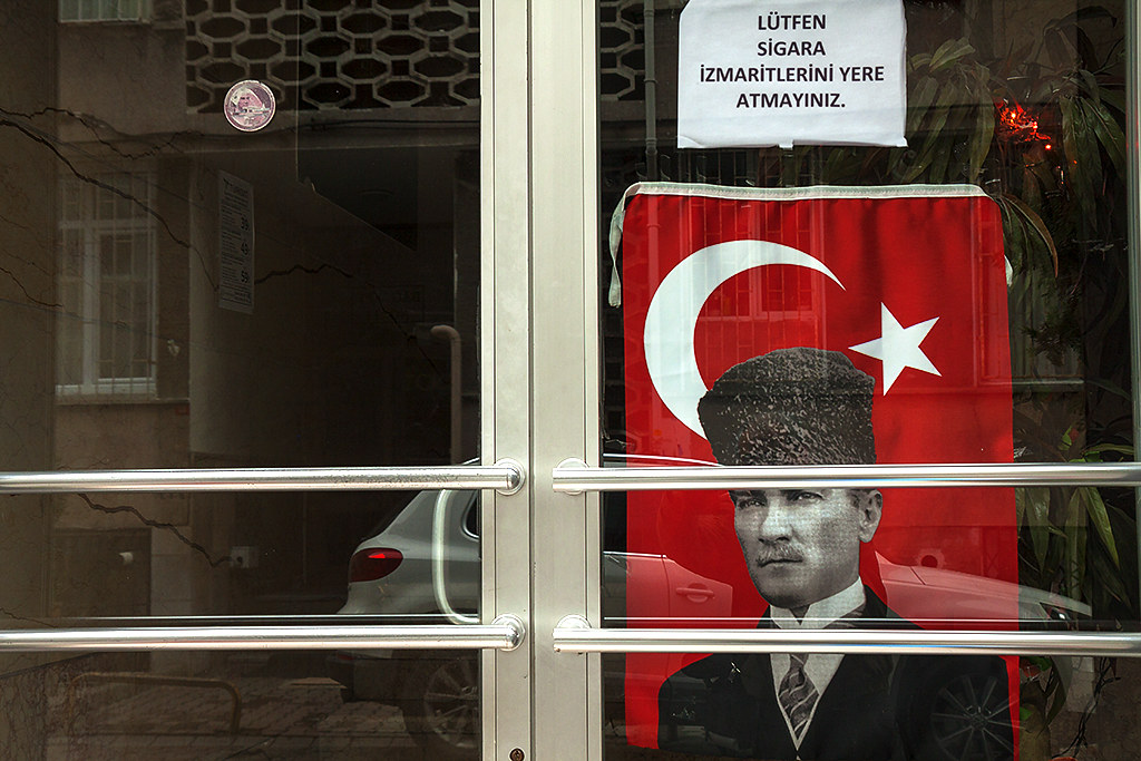 Flag with image of Mustafa Kemal Ataturk inside doors--Istanbul